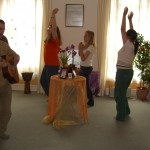 devotees singing around a table